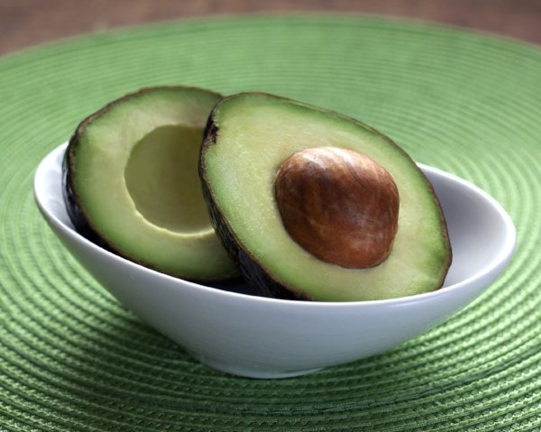 cut avocado in a white bowl