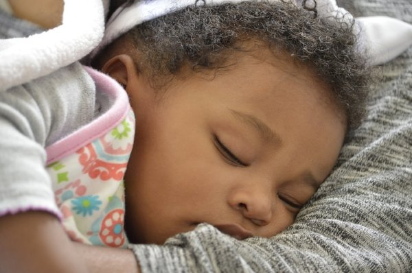 sleeping baby in arms