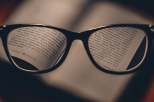 reading glasses focusing on a book