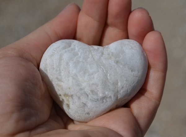 heart shaped rock in hand