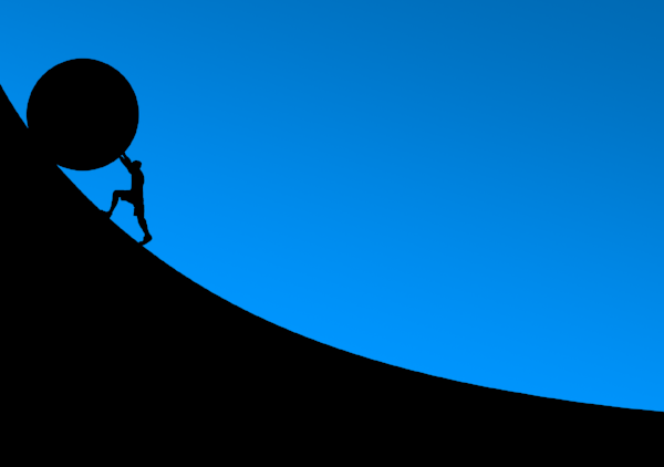 person pushing up a slope