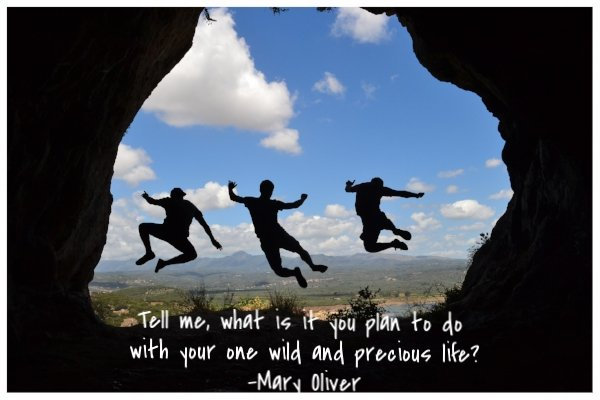 silhouette of three people jumping in a cave with a quote below